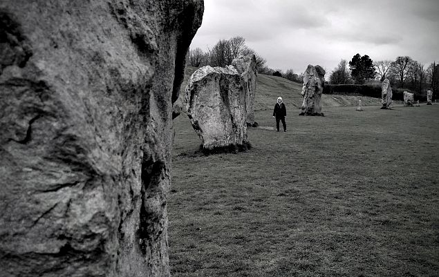 Avebury is a Neolithic henge monument containing three stone circles, around the village of Avebury in Wiltshire, in southwest England. One of the best known prehistoric sites in Britain, it contains the largest stone circle in Europe